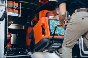 water damage restoration equipment put in truck