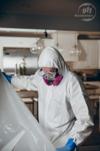 mold removal technician taping off part of a home